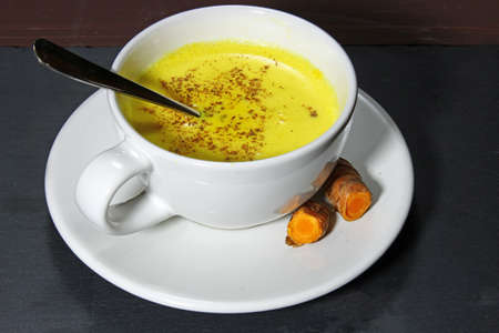 warming therapy: Turmeric Latte, or golden milk or Haldi doodh and Indian health drink.