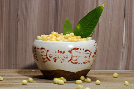 A bowl of chickpea flour balls or Indian Boondi on wooden background.
