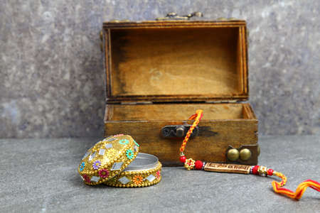 A Rakhi for Rakshabandhan with a wooden box