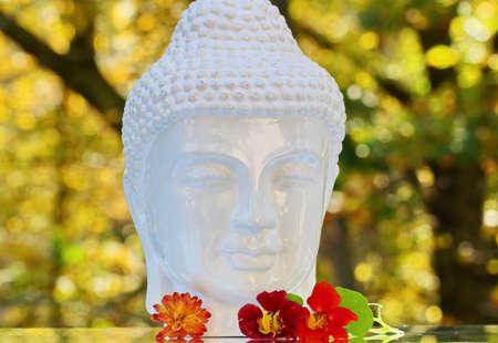 A white porcelain statue of Gautam Buddha
