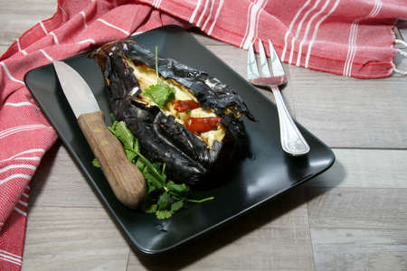 Roasted Eggplant with garlic and red chilli pepper on a plate