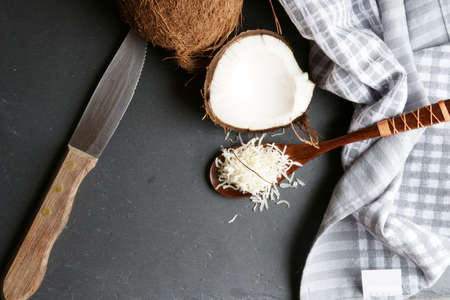 Top down view of Coconut oil, coconut flakes on grey stone background. Stock Photo