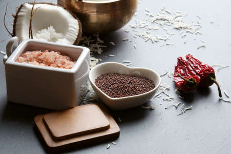 Mustard seeds and Himalayan salt with other spices and Coconut oil, ingredients for cooking. Selective focus.