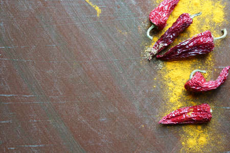 Turemric powder with dried red chillies and copy space. Stock Photo