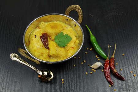 Kadhi, dumplings with yogurt sauce curry an Indian comfort food.