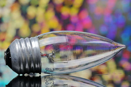 A small transparent bulb on a colorful bokeh background.