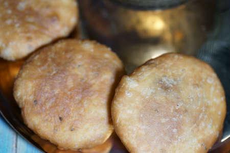 A close up of Khasta kachauri on a plate.