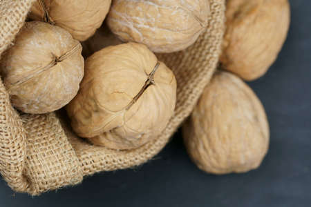 A bag of unshelled Walnuts with copy space. Stock Photo