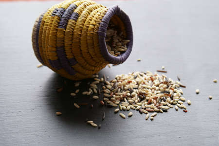 A container with wild rice with copy space.