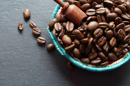 Overhead view of a container with coffee beans with copy space.