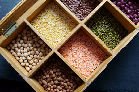 A box of different Indian legumes or pulses. Stock Photo