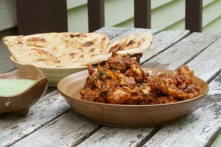Veiw of  homemade Tava Chicken with green raita chutney and Tandoori Roti