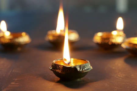 Metal Diyas lit up for the Indian Hindu festival of Diwali, the festival of lights.