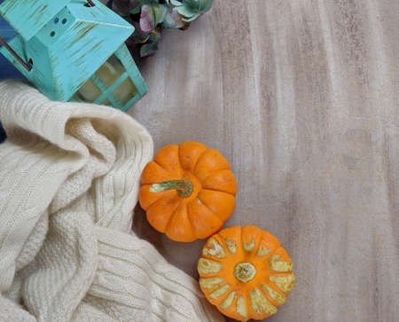 Top down view of Pumkins and swaeter and a candle Stock Photo