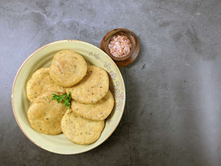 Overhead view of Mathri, an Indian snack made of  whole wheat flour or all purpose flour with fenugreek leaves and Carom seeds, with copy psace. Stock Photo