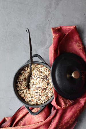 Overhead view of a pot with mixed Wild Rice with copy space.