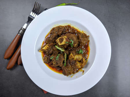 Overhead view of Goat curry, Mutton curry, Nihari, Rogan Josh in a bowl . Banco de Imagens