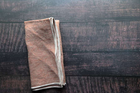 Overhead view of flat lay background of a napkin towel with copy space.