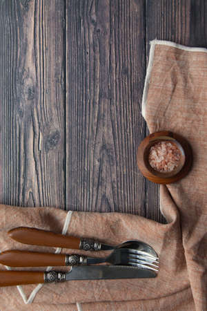 Overhead view of flat lay background of a napkin and cutlery with copy space.