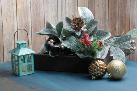 A Tray with Christmas decorations and a candle lamp.