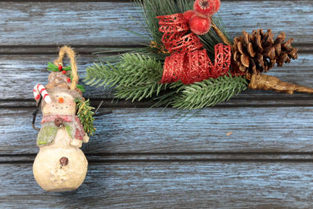 Christmas decorations on a wooden background with copy space.