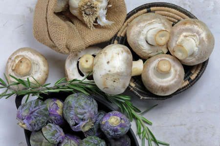 Top down view of purple Brussels Sprouts and white Button Mushrooms with a sprig of Rosemary Banco de Imagens