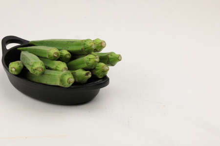 A bundle of fresh Ladys finger or Okra on wooden background with copy space.
