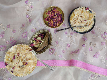 Seviyan or Vermicelli kheer, an Indian dessert made of semolina noodles topped with rose petals and dry fruits such as Cashews.