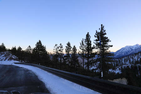 A road near Lake Tahoe with view of Mountains in winter.