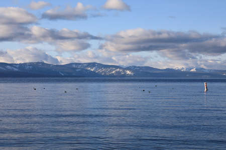 Scenic overlook Lake Tahoe from the shores with mountains.