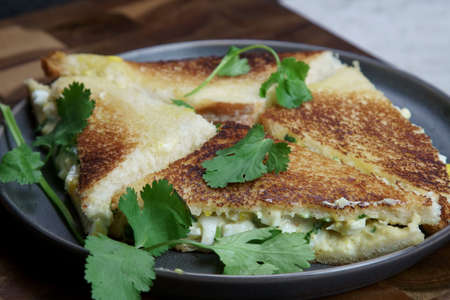 A plate of Bread and egg salad with mayonaise sandwich on a plate with copy space.
