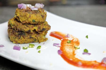 Spicy Black Gram or kala Chana tikki or Kabab on a plate.