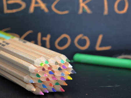 A board with text back to School with school supplies. Back to school concept.
