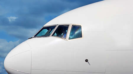 jumbo jet: Large airplane nose closeup with blue sky background