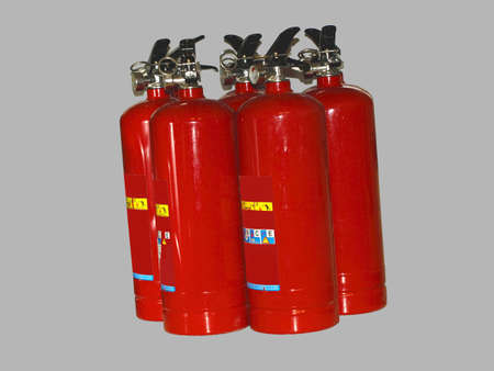 extinguishers: Extinguishers, grey background Stock Photo