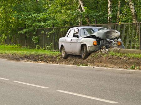 Car, tumbled down a column Stock Photo