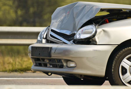 crashed: broken new car, detailed closeup