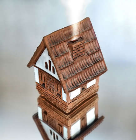 the brick house; mirroring, isolated       Stock Photo - 4805083