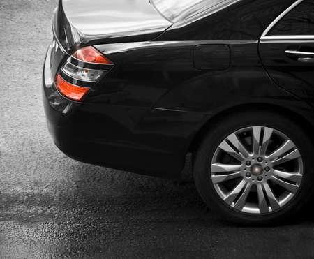 dichromatic: Closeup of black sedan