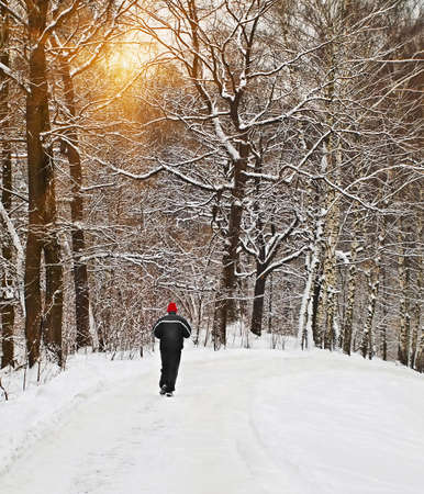 lone runner in wintry forest photo