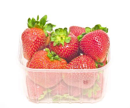 big strawberries in plastic package photo