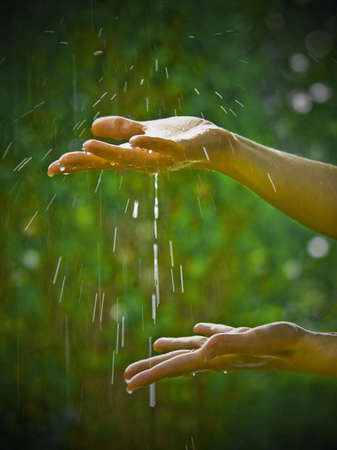 woman squirt: female hands with raindrops Stock Photo