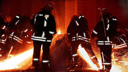 firefighters team with circular saws photo