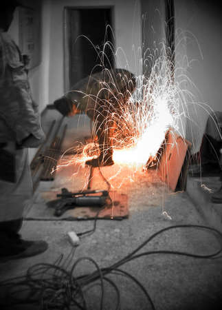 metalworker: Metalworker sawing a new pipe (dualtone) Stock Photo