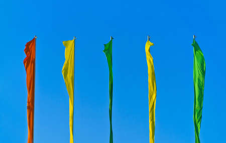 flagpoles: Colored flags on flagpoles
