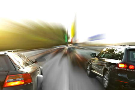 speeding car: two sport-cars in blurry motion Stock Photo