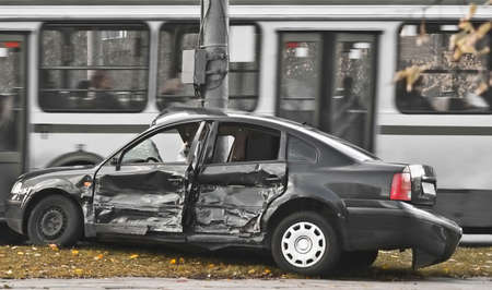 mishap: broken-up car, urban traffic  Stock Photo