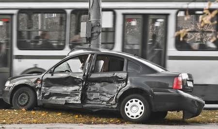 incident: broken-up car, urban traffic  Stock Photo