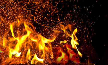 windy energy: bonfire with sparks, close-up
