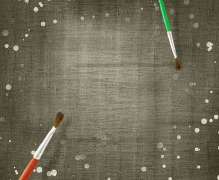 grungy canvas with paint-brushes photo
